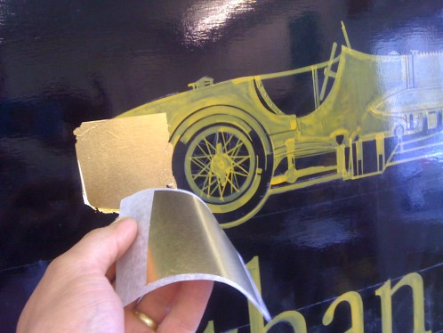 23 carat Gold leaf is applied by hand to the design painted in specialist gold size.