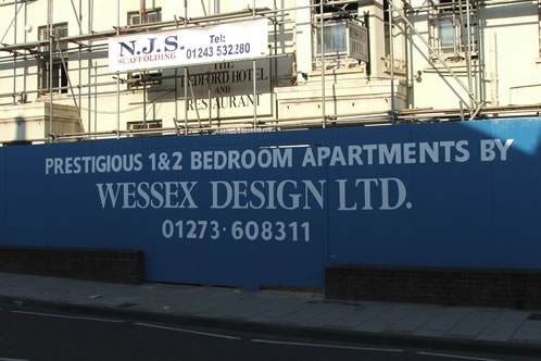 Painted building site Hoarding lettering