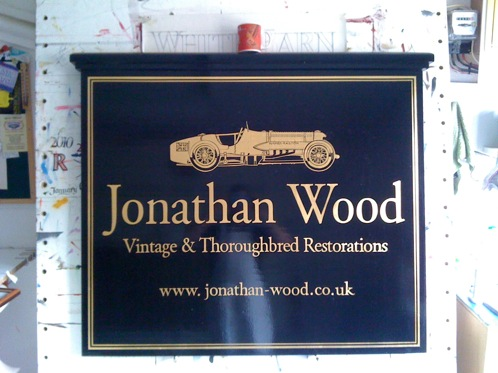 Large timber and gold leaf signwritten hanging sign with Car design