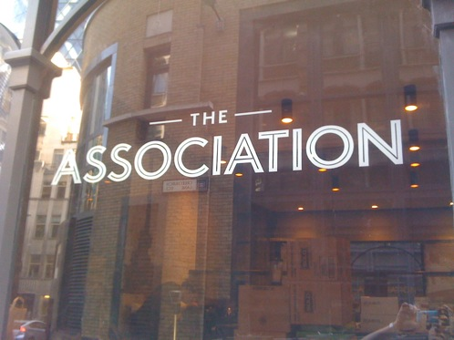 Glass signwriting at Association Coffee in London