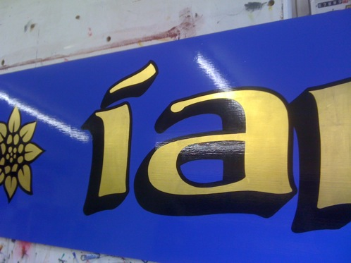 Hand painted Gold leaf lettering with a black block shade and outline