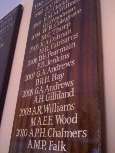 Gold leaf names on a mahogany honours roll board