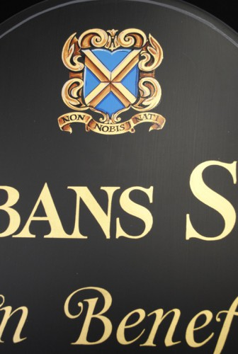 Hand painted Heraldic Crest signwritten on a Schools honours board for St Albans School
