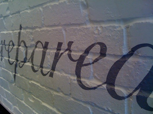 Hand painted lettering to rough brick surfaces