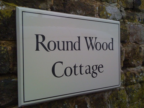 Hand painted timber house sign in brush painted Roman style  lettering