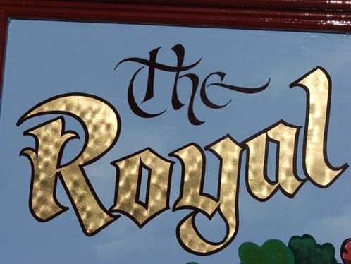 gold leaf lettered pub sign