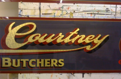 traditional gold leaf lettering with shadow and shade used for a family butchers shop