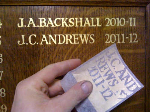 Gold leaf lettering on school honours boards