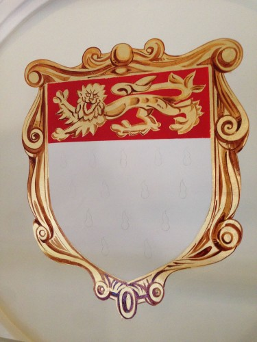 Chichester Assembly Rooms coat of arms with painting in progress