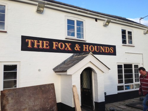 Pub sign for the Fox and Hounds, Denmead, Hants