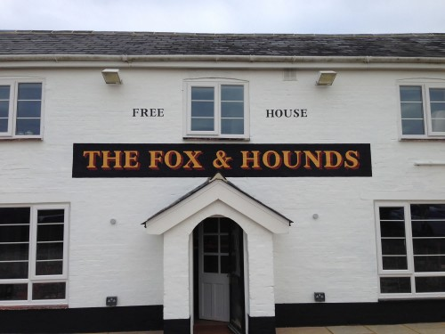 Pub sign painted direct onto the external wall of the Fox and Hounds in Denmead, Hants
