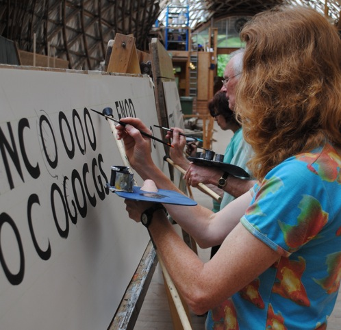 Students Hand Painting Letters At A Signwriting Class