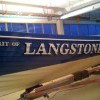 Hand painted traditional signwriting on a Victorian wooden rowing gig boat