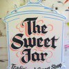 Shaped handmade and painted wooden sign