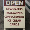 Handmade and painted newsagent sandwich sign