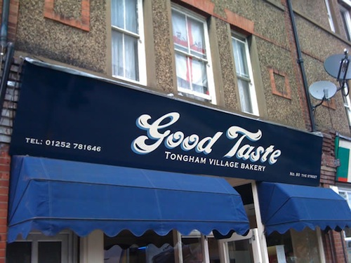 Fascia sign for Good Taste bakery in Tongham, Surrey